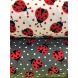 LADYBIRD-FLEECE-FABRIC-GREY-AND-WHITE-BLANKETS-THROWS-TOYS