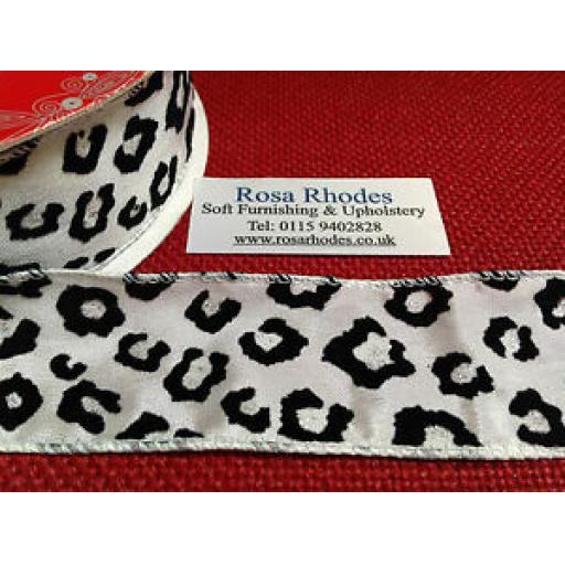 CHRISTMAS WIRE EDGED RIBBON - BLACK ANIMAL PRINT ON WHITE WITH SILVERY GLITTER